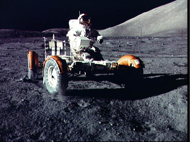 Astronaut Eugene Cernan drives the Lunar Roving Vehicle during the first EVA. Credit: NASA