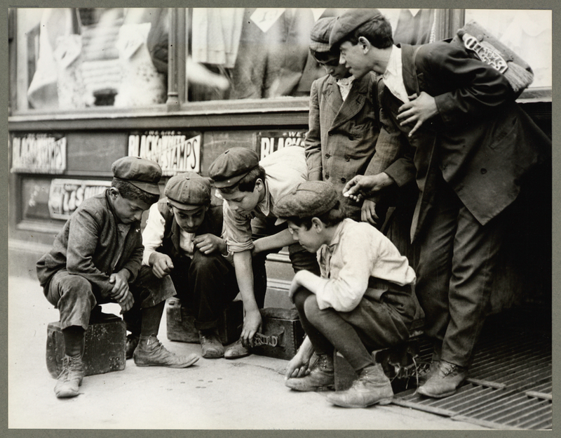 """Newsboys and bootblacks shooting craps,"" 1912. Courtesy of The New York Public Library."