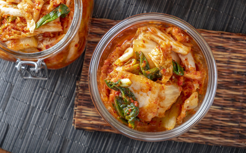 Korean kimchi, made of salted and fermented vegetables, contains microbes that contribute to its distinctive taste. 4kodiak/Getty Images