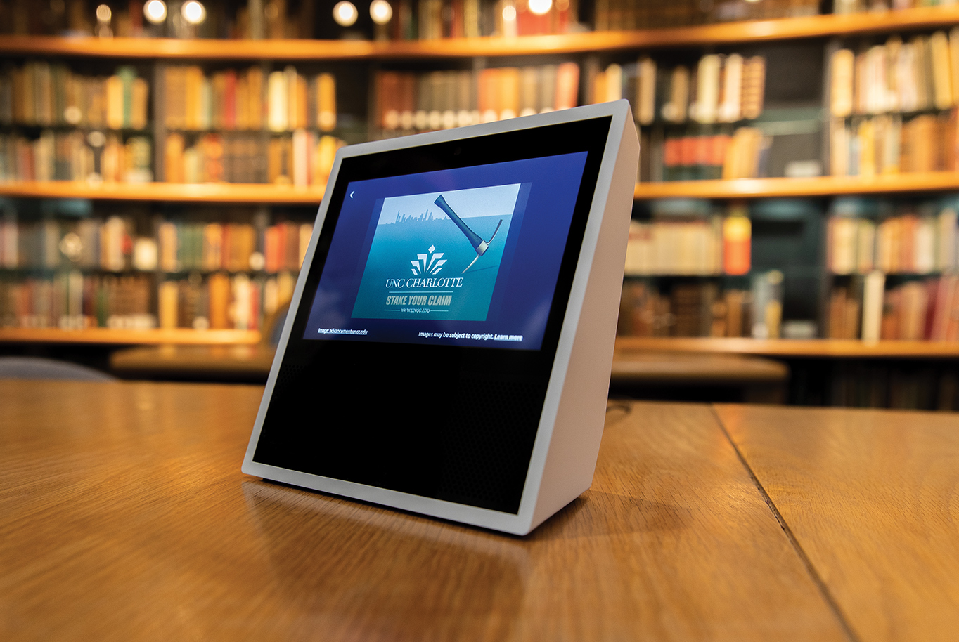 An Amazon Echo Show helps visually impaired students use the library catalog at the University of North Carolina at Charlotte. Photography by: Peter Taylor.