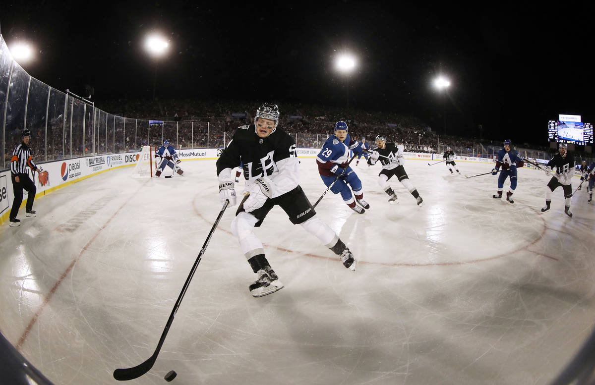Los Angeles Kings left wing Austin Wagner, front, picks up the puck as Colorado Avalanche cente ... Los Angeles Kings left wing Austin Wagner, front, picks up the puck as Colorado Avalanche center Nathan MacKinnon defends during the third period of an NHL hockey game Saturday, Feb. 15, 2020, at Air Force Academy, Colo. The Kings won 3-1. (AP Photo/David Zalubowski)
