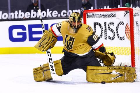 Golden Knights goaltender Marc-Andre Fleury (29) blocks the puck during the first period of an NHL hockey game against the Colorado Avalanche at T-Mobile Arena in Las Vegas on Sunday, Feb. 14, 2021. (Chase Stevens/Las Vegas Review-Journal) @csstevensphoto